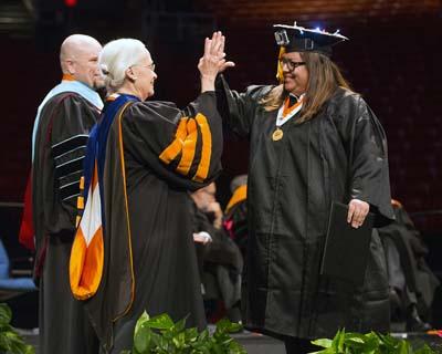 Diana Natalicio awarding diploma to graduate
