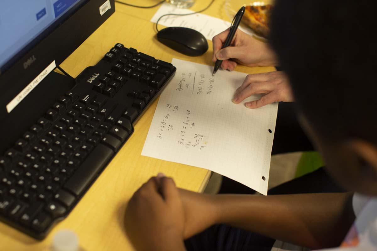 Student and teacher work on math problems