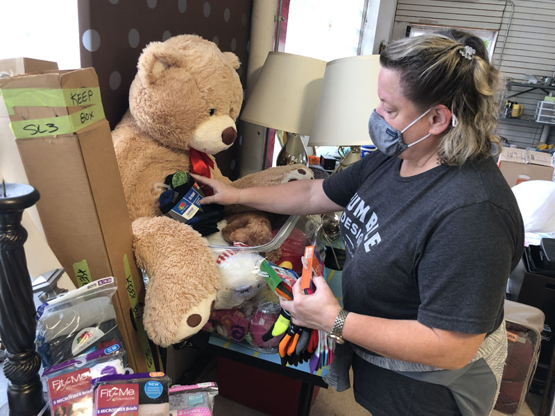 Female prepares toys and study items for donation