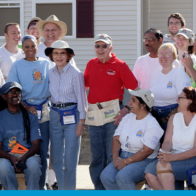 President and Mrs. Jimmy Carter in group of Habitat for Humanity volunteers.
