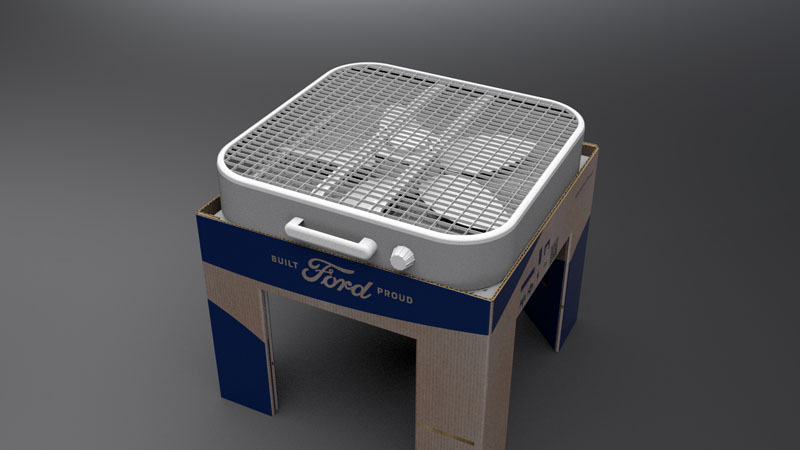 Fan atop air filter and cardboard stand