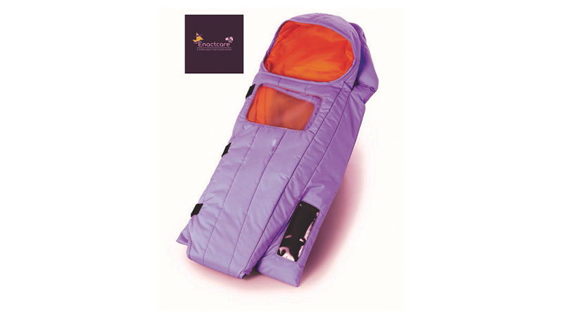 A small purple sleeping bag style incubator for babies